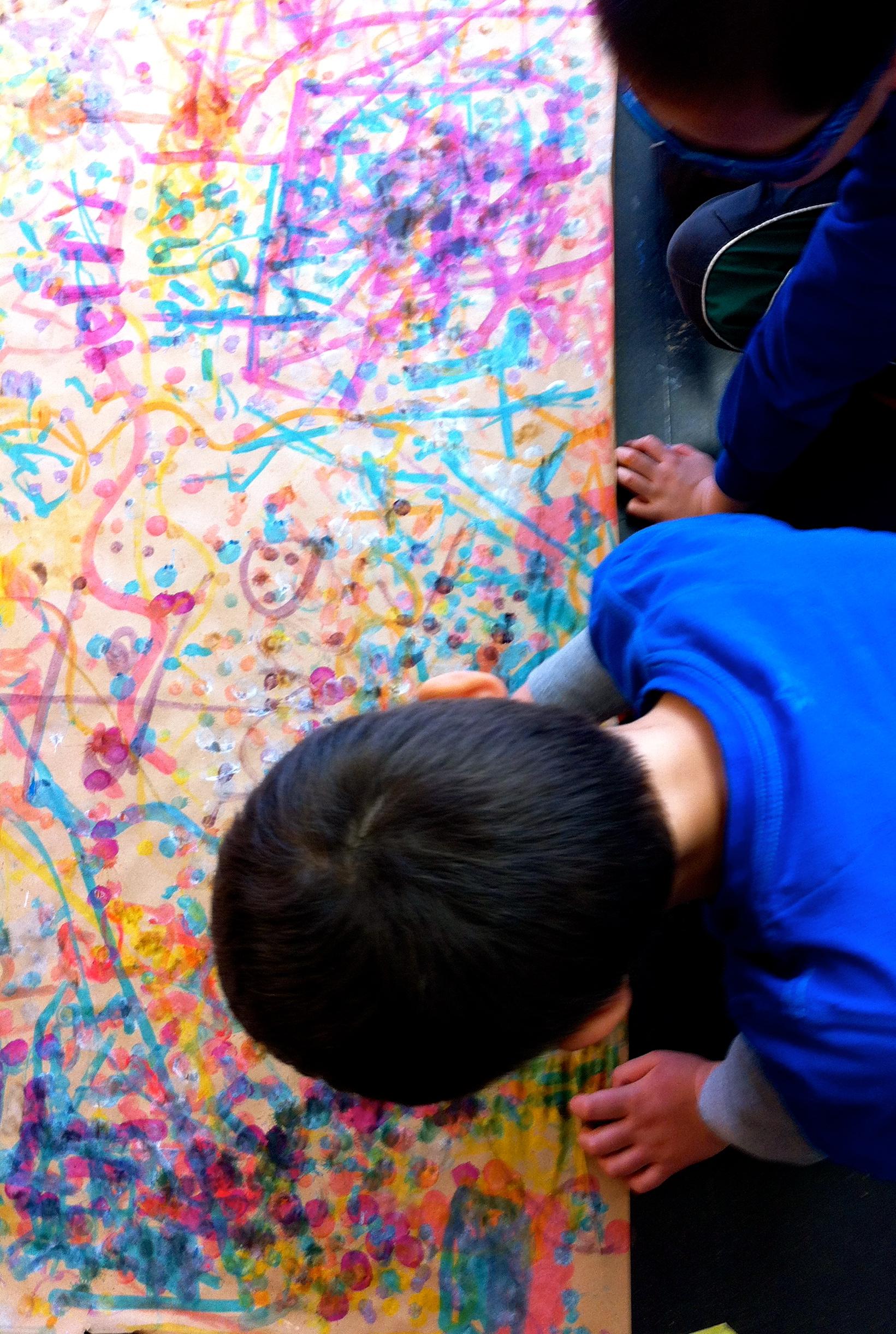 Abstraction: Jackson Pollack mural. (Grade 1)