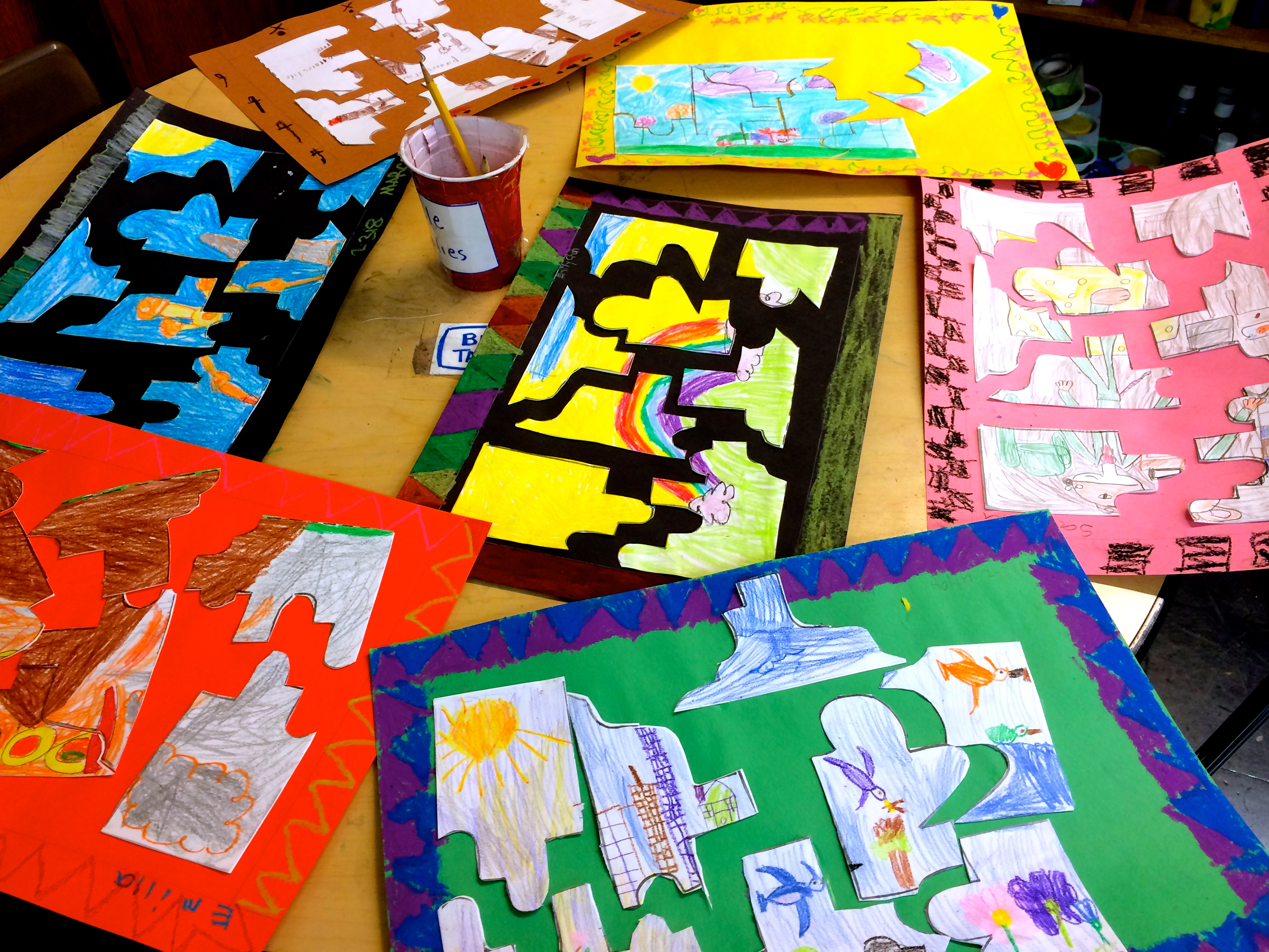 Puzzles. Mixed Media Collage, crayons on tagboard. (Grade 2)